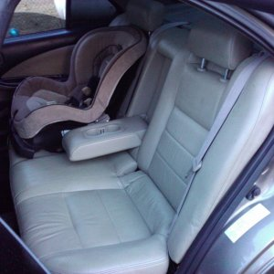 Rear seats with armrest & adjustable head rest